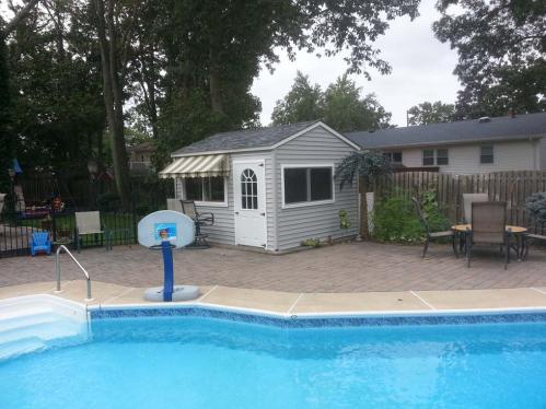 "10x12 ""Pool Bar"" gray vinyl siding, 2 bar windows 72x36, 2- 36 inch 11-lite doors, slatestone gray roof"