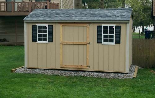 8x14 primed utility gable, pewter gray roof, 48 inch door, 2 windows, black shutters