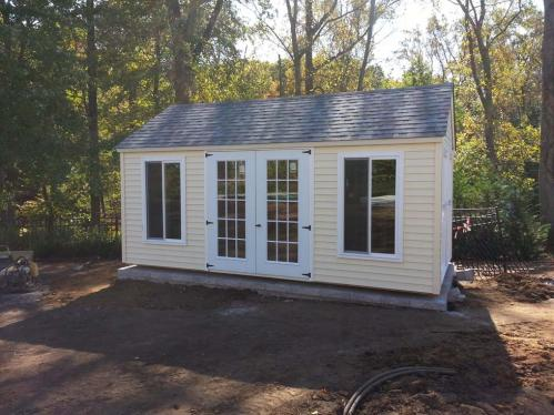 "10x16 ""sunroom"" cream vinyl siding, double 36 inch 15 lite doors, two 36x60 slider windows, slatestone gray roof"